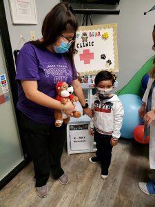 Nurse Giving Teddy Bear To Boy